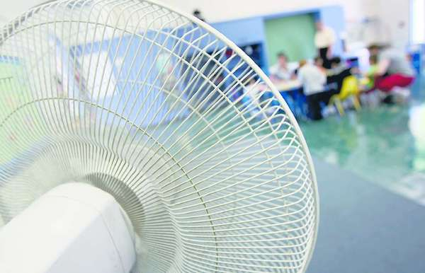A fan cools off a Burbank classroom.