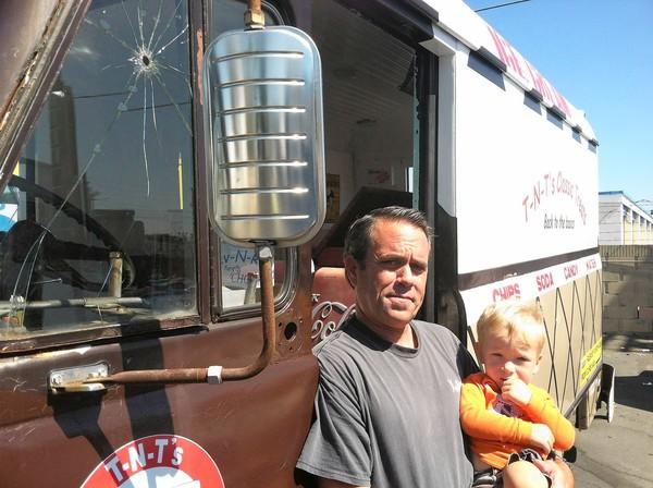 Todd Olympius cradles his 1-year-old son, Collin, next to the restored ice cream truck that he will bring to Costa Mesa's 60th Anniversary celebration this weekend.