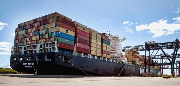 The cargo ship MSC Texas, which measures 1095 feet long, docked at Port Everglades. It repersents a new wave of massive cargo vessels called post-Panamax, which are capable of navigating the wider and deeper Panama Canal which will open in 2015.