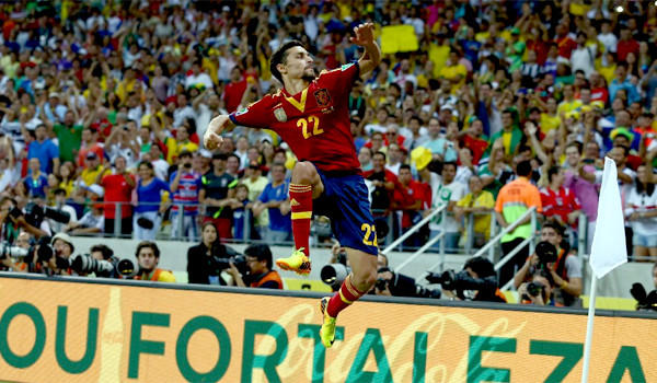 Jesus Navas celebrates scoring the winning penalty in a shootout during the FIFA Confederations Cup Brazil 2013 semifinal match between Spain and Italy.