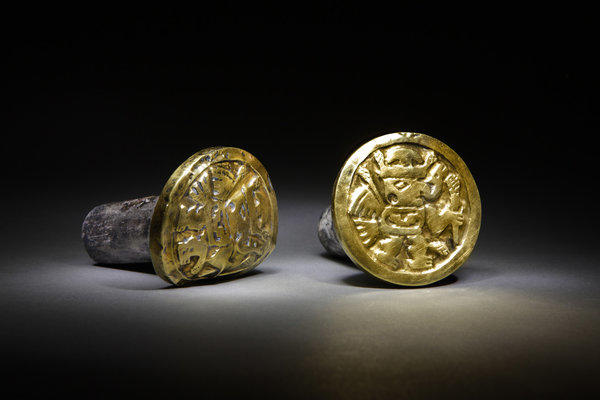 Archaeologists discovered these gold-and-silver ear ornaments, which a Wari woman wore to her grave, among more than 1,200 artifacts from a mausoleum in Peru.