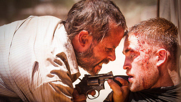 "Guy Pearce, left, and Robert Pattinson star in the slow-burn thriller ""The Rover"" due out from A24 Films."