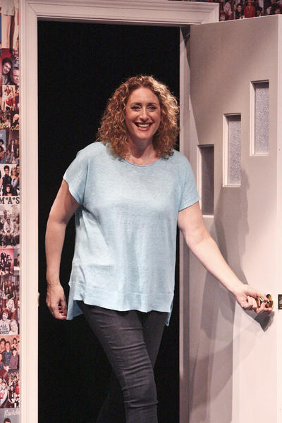 "Judy Gold comes onstage through a door stage right, just like the sitcom characters she aspires to be, in her one-woman show ""The Judy Show: My LIfe as a Sitcom"" at the Geffen Playhouse's Audrey Skirball Kenis Theater."