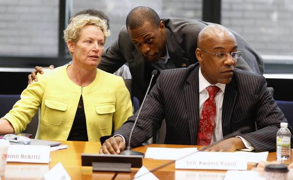 State Rep. Elaine Nekritz, D-Northbrook, confers with Ron Holmes, spokesman for Illinois Senate President John Cullerton, at the start of Thursday's pension conference committee meeting. At right is Sen. Kwame Raoul , D-Chicago, the committee's chairman.