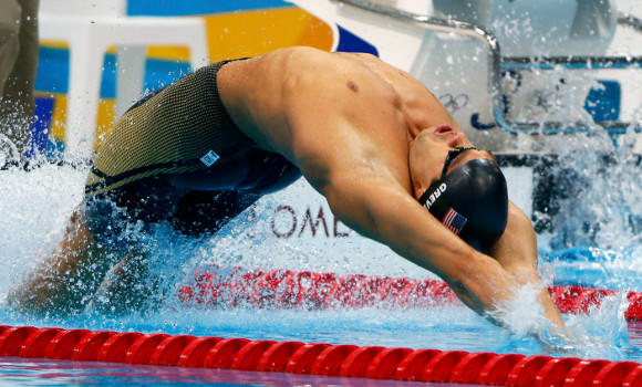 Matt Grevers starting his gold-medal Olympic swim in the 100-meter backstroke.