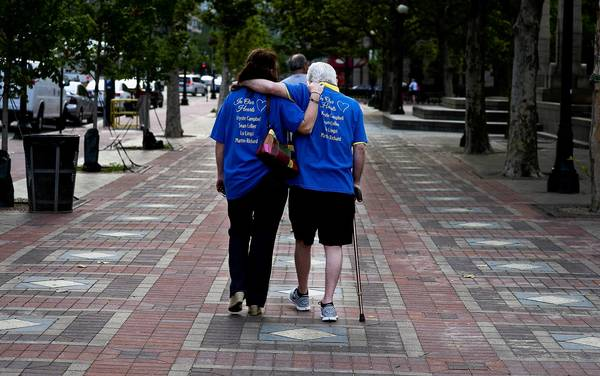 The parents of one of those killed in the Boston Marathon bombings, Richard and Patricia Campbell, walk together after visiting a makeshift memorial for the victims in Copley Square shortly before it was cleared away. A permanent memorial is in the works.