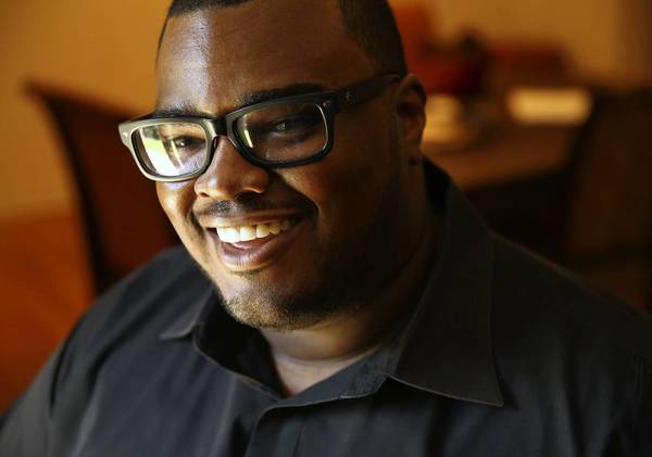 Marques Sullivan, president of the Retired Professional Football Players of Chicago, will march with Wade Davis, an ex-NFL cornerback who announced last year that he is gay, in Chicago's Pride Parade on Sunday.