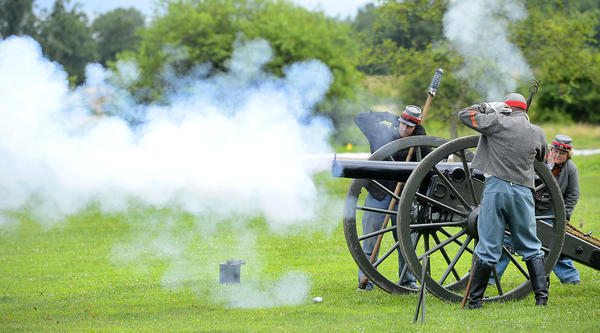 Re-enactors from Cushing/Taylor Battery in Erie, Pa., participate in the cannon firing for the Opening Ceremony for The 150th Commemoration and Re-enactment of the Battle of Gettysburg.