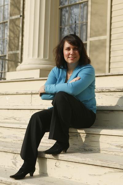 Real estate consultant Tina Feldstein pictured on the steps of the Clarke House (Chicago's oldest) on Prairie Ave. in the South Loop on Wednesday, March 14, 2007. Tina has always had a passion for this neighborhood and is the board president of the Prairie District Neighborhood Alliance.