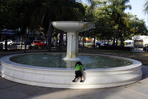 A young girl plays at the fountain at Leimert Park, not far from a future MTA station.