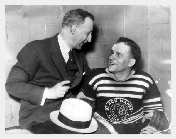 Tommy Gorman congratulates goalie Chuck Gardiner after a victory early in the 1934 Stanley Cup series.