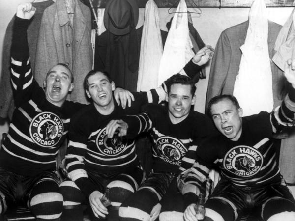 "Jack Shill, Carl Voss, Cully Dahlstrom and Harold ""Mush"" March celebrate in the locker room after they defeated the Toronto Maple Leafs in Game 4 of the 1938 Stanley Cup Finals."