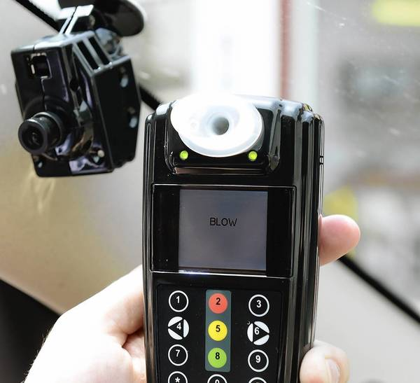 As of Monday, a camera, left, will monitor the in-car breath test required of a motorist charged with DUI.
