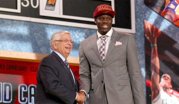Forward Anthony Bennett, selected out of UNLV with the No. 1 overall pick by the Cleveland Cavaliers, shakes hands with NBA Commissioner David Stern at the 2013 NBA Draft.