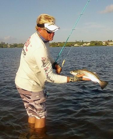 "Blair Wiggins, the host of ""Addictive Fishing"" on Sun Sports, with a sea trout that he caught on a DOA plastic shrimp and one of his Signature Series spinning rods while wading a grass flat in Stuart."