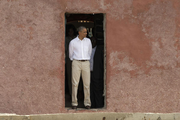 "President Obama stands facing out to sea at the ""Door of No Return"" at a slave house on Goree Island in Dakar, Senegal, from which Africans were shipped across the Atlantic Ocean into slavery."