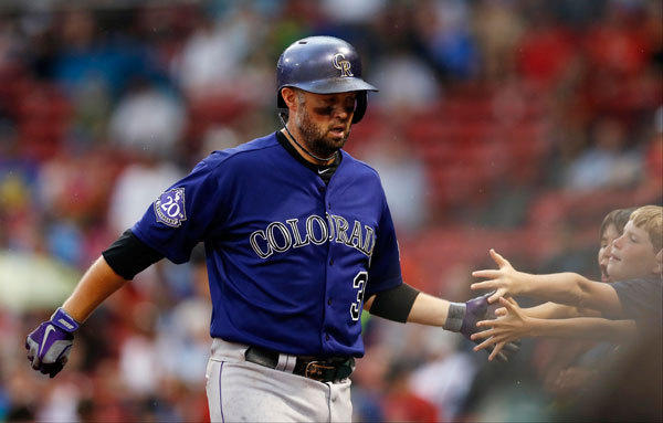 Colorado Rockies right fielder Michael Cuddyer (3) is greeted by fans after hitting a home run during the eighth inning against the Boston Red Sox at Fenway Park.
