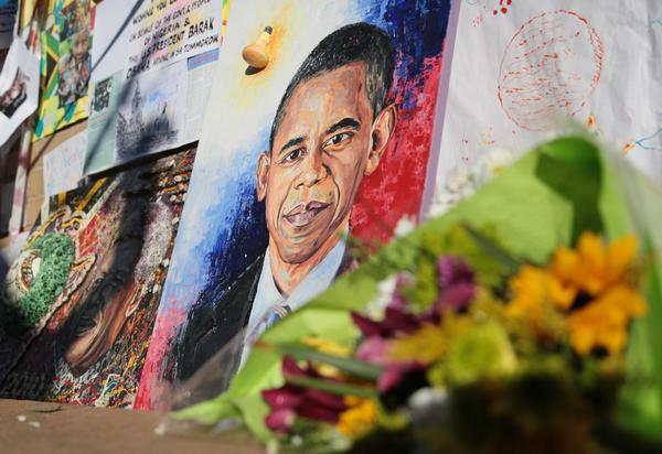 A painting depicting President Obama is on display outside the hospital where former South African President Nelson Mandela is said to be in critical condition.