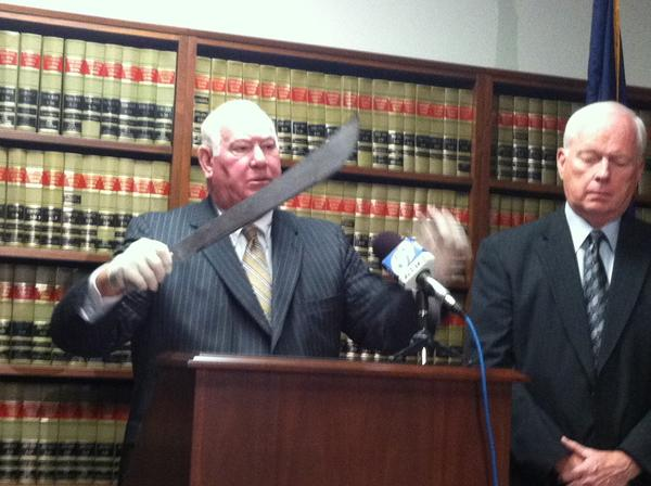 Lehigh County District Attorney Jim Martin holds a machete during a Friday press conference announcing the findings of an investigation of the police-officer involved shooting of a machete-wielding man in Allentown.