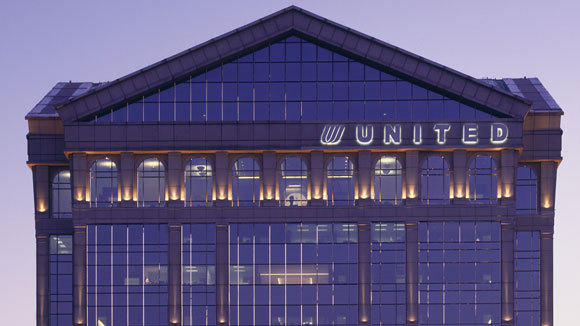 the tulip logo and u n i t e d letters are shown on the airlines former headquarters at 77