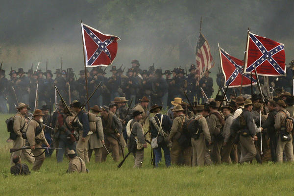 Reenactors demonstrate a battle during ongoing activities commemorating the 150th anniversary of the Battle of Gettysburg on Friday at Bushey Farm in Gettysburg, Pa.