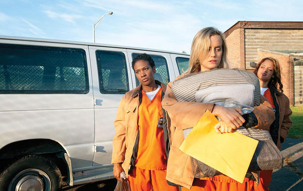 "Taylor Schilling, center, as Piper Chapman in ""Orange Is the New Black."""