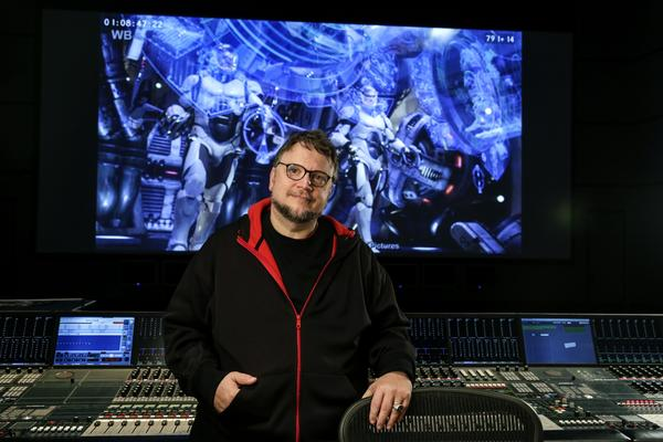"Director Guillermo del Toro, in the mixing studio at Warner Bros. in Burbank, has a new movie coming out called ""Pacific Rim,"" a shot of which is on in the background, about an alien attack threatening the Earth's existence. Giant robots piloted by humans are deployed to fight off the menace."