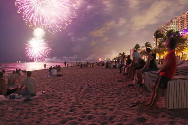 The Fort Lauderdale Fourth of July firework show glows over Fort Lauderdale beach.
