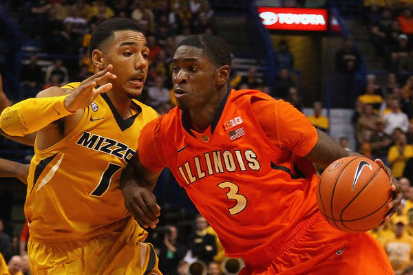 Former Illini Brandon Paul drives to the basket against Phil Pressey of Missouri in 2012.