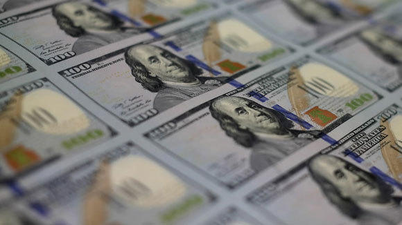 Redesigned $100 notes lay in stacks at the Bureau of Engraving and Printing last month in Washington, D.C.