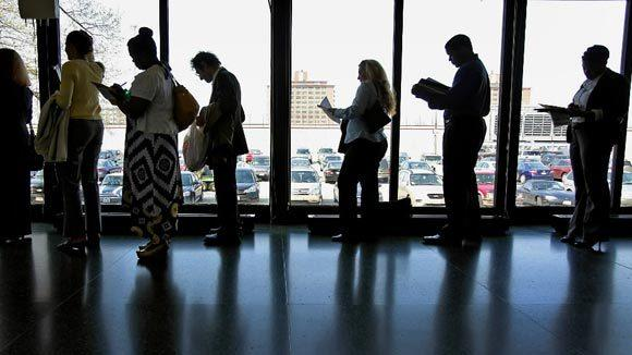 Participants line up for a jobs fair in Illinois.