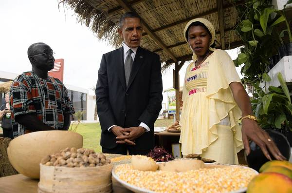 President Obama visits with Papa Sene, left, of the National Cooperative Business Assn. and Oumou Gadio during an event in Dakar, Senegal, focusing on food security in Africa.