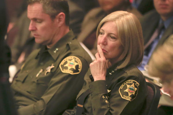 Criminal justice realignment laws adopted in 2011, known as AB 109, gives counties new responsibilities over low-level felons. Above: Orange County Sheriff Sandra Hutchens, right, listens while Garden Grove Police Dept. Chief Kevin Raney makes a case to the Orange County Board Of Supervisors for increased funding for AB 109.