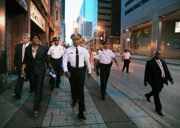 Mayor Stephanie Rawlings-Blake, left, and police commissioner Anthony W. Batts, center, and their entourages walk along Baltimore Street and talk with business owners about crimes in the downtown and Inner Harbor areas They started the tour after a visit to Baltimore Police CitiWatch headquarter on Howard Street.