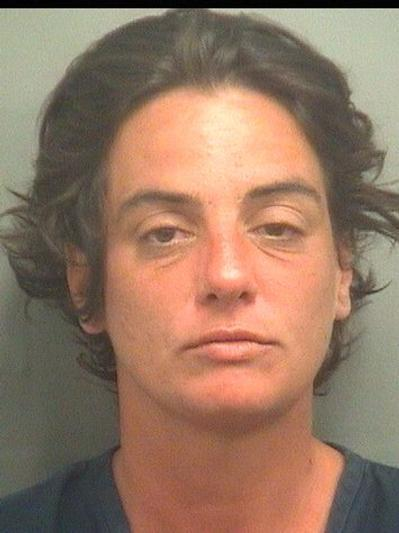 After police said Barbara Erol Rosa,35, of West Palm Beach, was arrested for an open container violation, they said she threatened to kill both officers with a shotgun and kicked one of them in the butt.