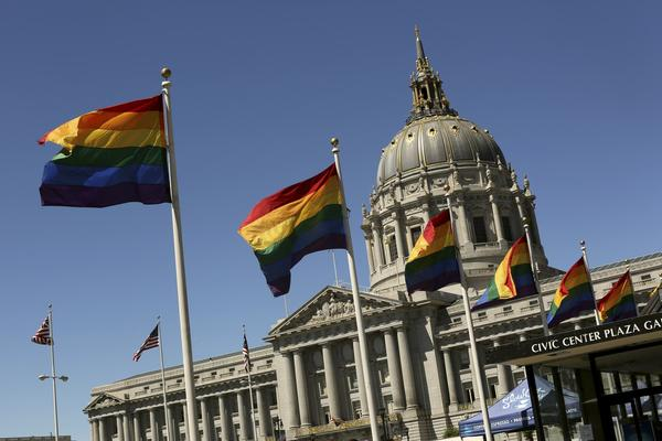Rainbow colored flags fly outside City Hall in San Francisco, California June 28, 2013. The U.S. Supreme Court on Wednesday handed a significant victory to gay rights advocates by ruling that married gay men and women are eligible for federal benefits and paving the way for same-sex marriage in California.