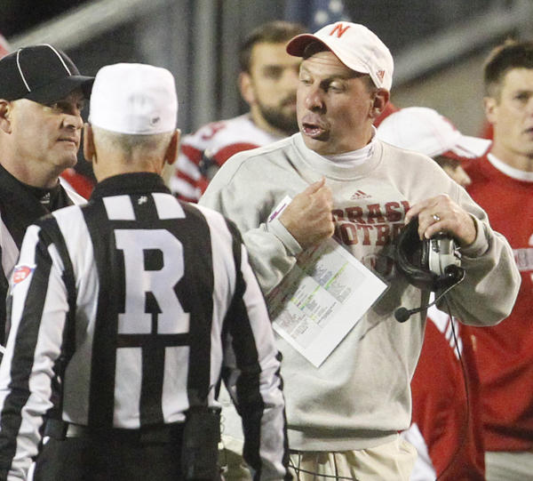 Nebraska coach Bo Pelini has an exchange of ideas with officials during the second quarter against Wisconsin at Camp Randall Stadium in Madison.