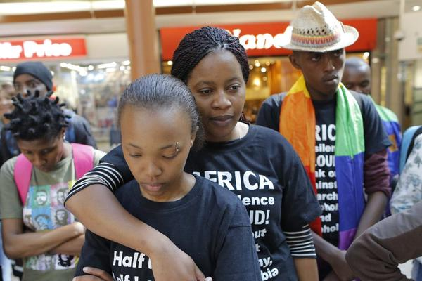 Activists gather during a flash mob event at a major city mall in Johannesburg, South Africa, to support the International Day against Homophobia and Transphobia.