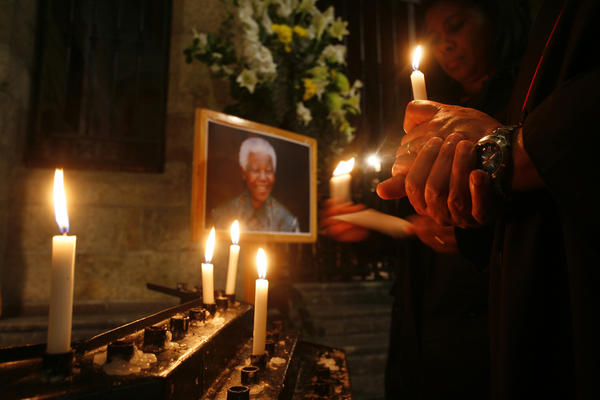 Wellwishers hold candles as they gather in support of ailing former South African President Nelson Mandela in a Cape Town Cathedral.