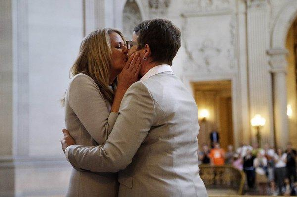 Sandy Stier, left, and Kris Perry share a long-awaited wedding kiss.