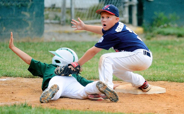 Federal's Tyler Remsburg, right, reacts to the call as West End's Caden Billman is safe on a close play at third base during the Maryland District 1 9-10 Tournament losers' bracket final at West End on Friday.
