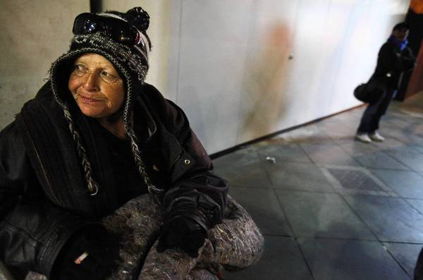 Diane Muldanado, 58, who has been homeless for 16 years, tries to stay warm in downtown Santa Monica in January.