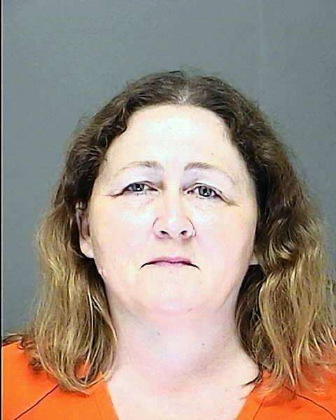 Holli Quick, 48, was arrested June 28, 2013 after her former employers at Dustin's Bar-B-Q in Edgewater said she forged nearly $112,000 worth of business and checks, made them out to herself and cashed them.