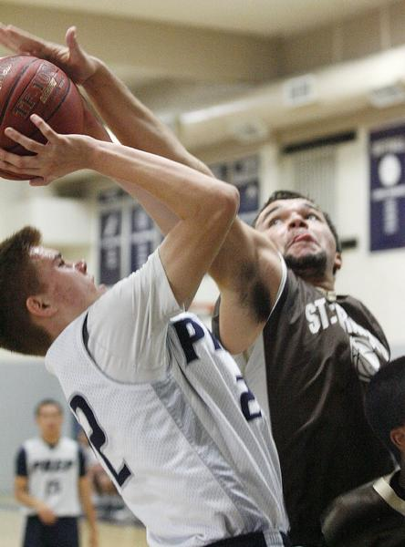 Flintridge Prep's Robert Cartwright, left, scored a game-high 27 points -- despite being defended by St. Francis' Noah Willerford here -- in a 60-56 loss to the Golden Knights.