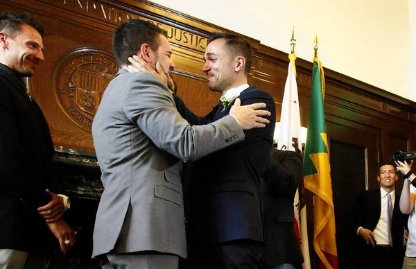 Jeff Zarrillo, left, and Paul Katami were married by Mayor Antonio Villaraigosa at City Hall on Friday.