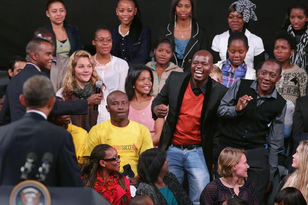 "A young man shows his excitement as President Obama calls on him for a question during a ""town hall"" meeting with the young African leaders at the University of Johannesburg in Soweto on Saturday."