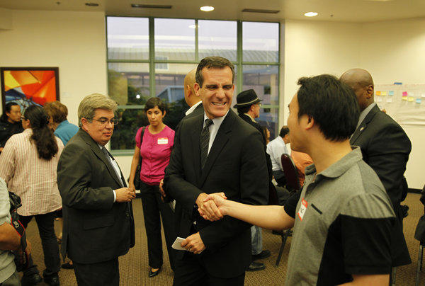 Mayor-elect Eric Garcetti greets participants at a community meeting inside the Grand Salon at Cal State Northridge.