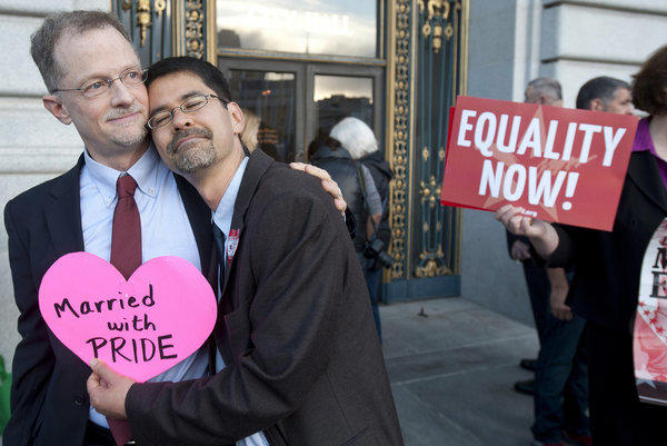 John Lewis, left, and Stuart Gaffney embrace outside San Francisco City Hall in anticipation of Wednesday's U.S. Supreme Court ruling that cleared the way for same-sex marriages to resume in California