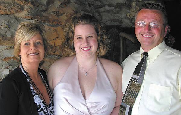 This May 2006 photo of Kim, Amber and Mike Shingler was taken at a wedding in which Amber was a bridesmaid.