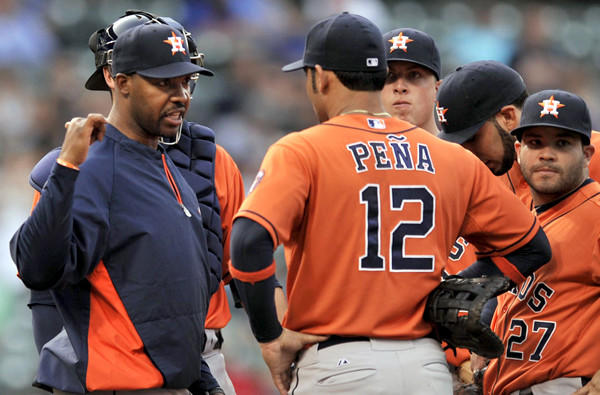 Houston Astros Manager Bo Porter discusses strategy with his infielders during a game against the Cubs last week in Chicago.